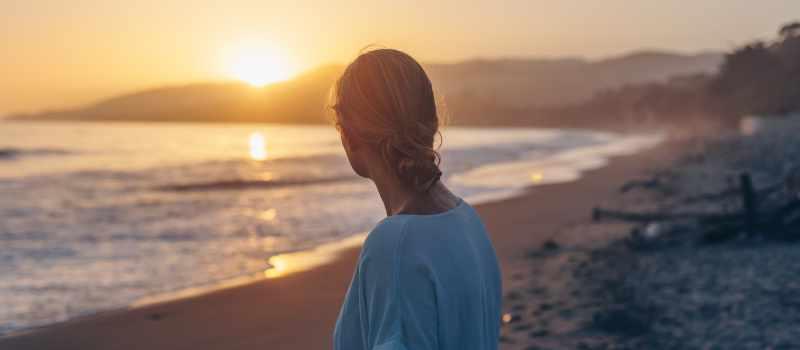 Woman gazing at sunset